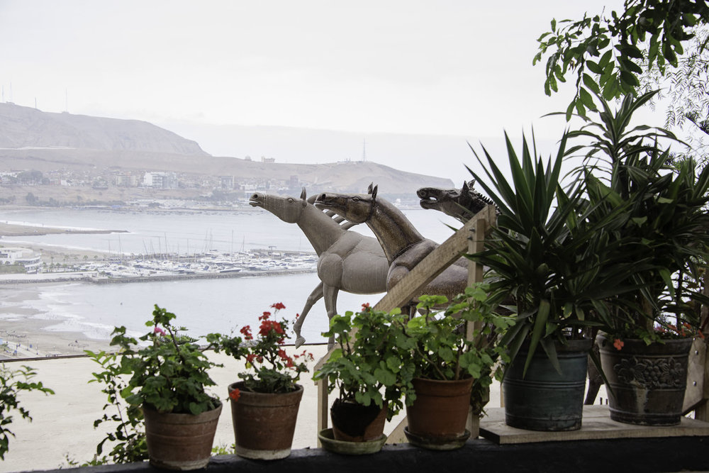 Horse Sculptures and Flowers at Second Home Peru in Lima.