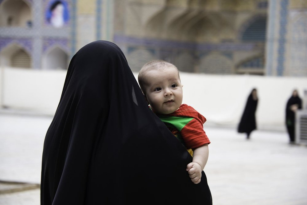 Muslim Woman Carrying a Baby
