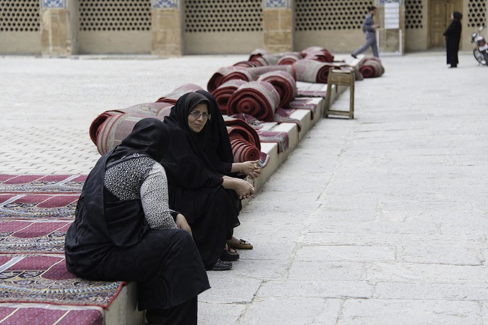 Muslim Women Sitting on Prayer Rugs