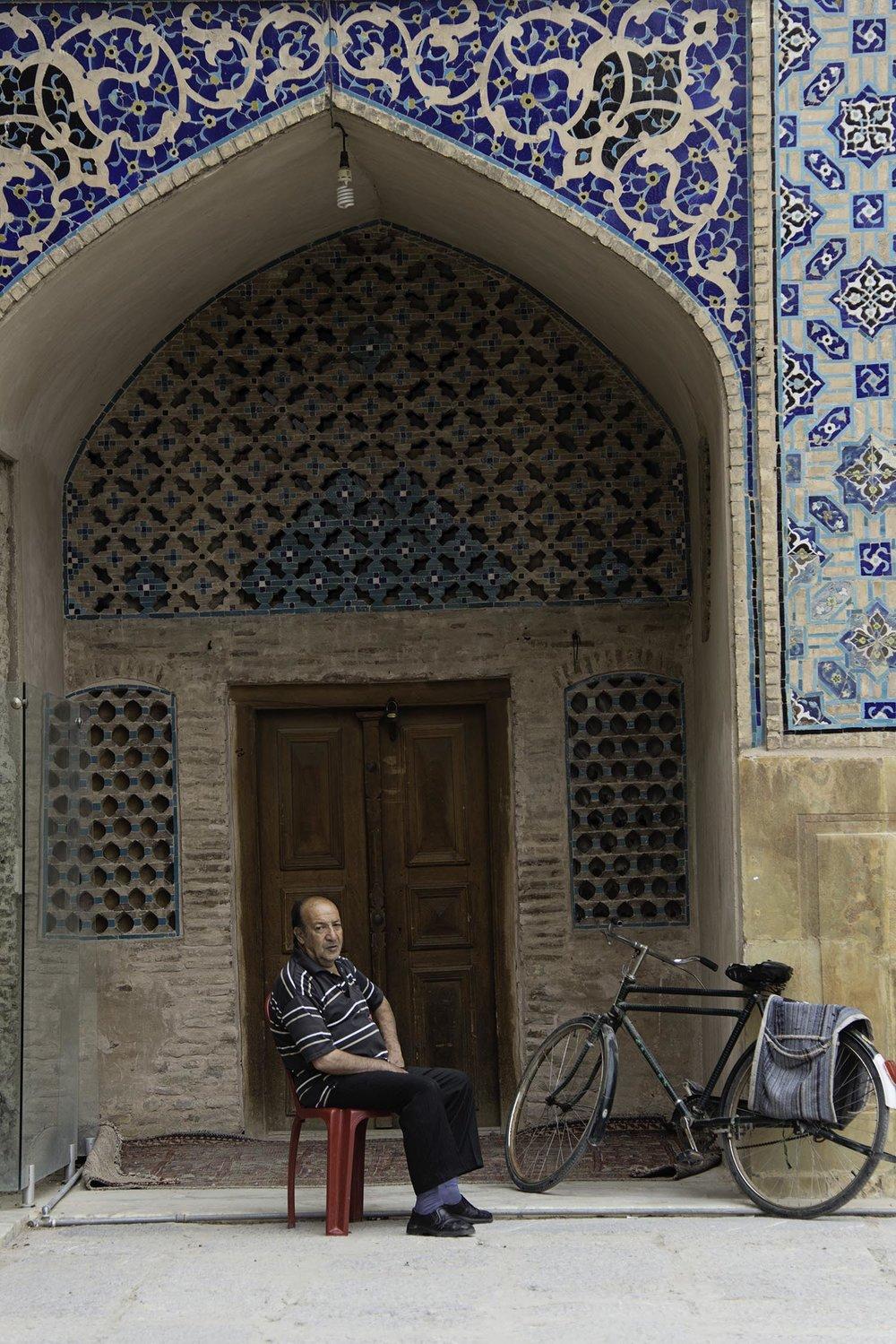 Iranian Man Sitting Under Arch
