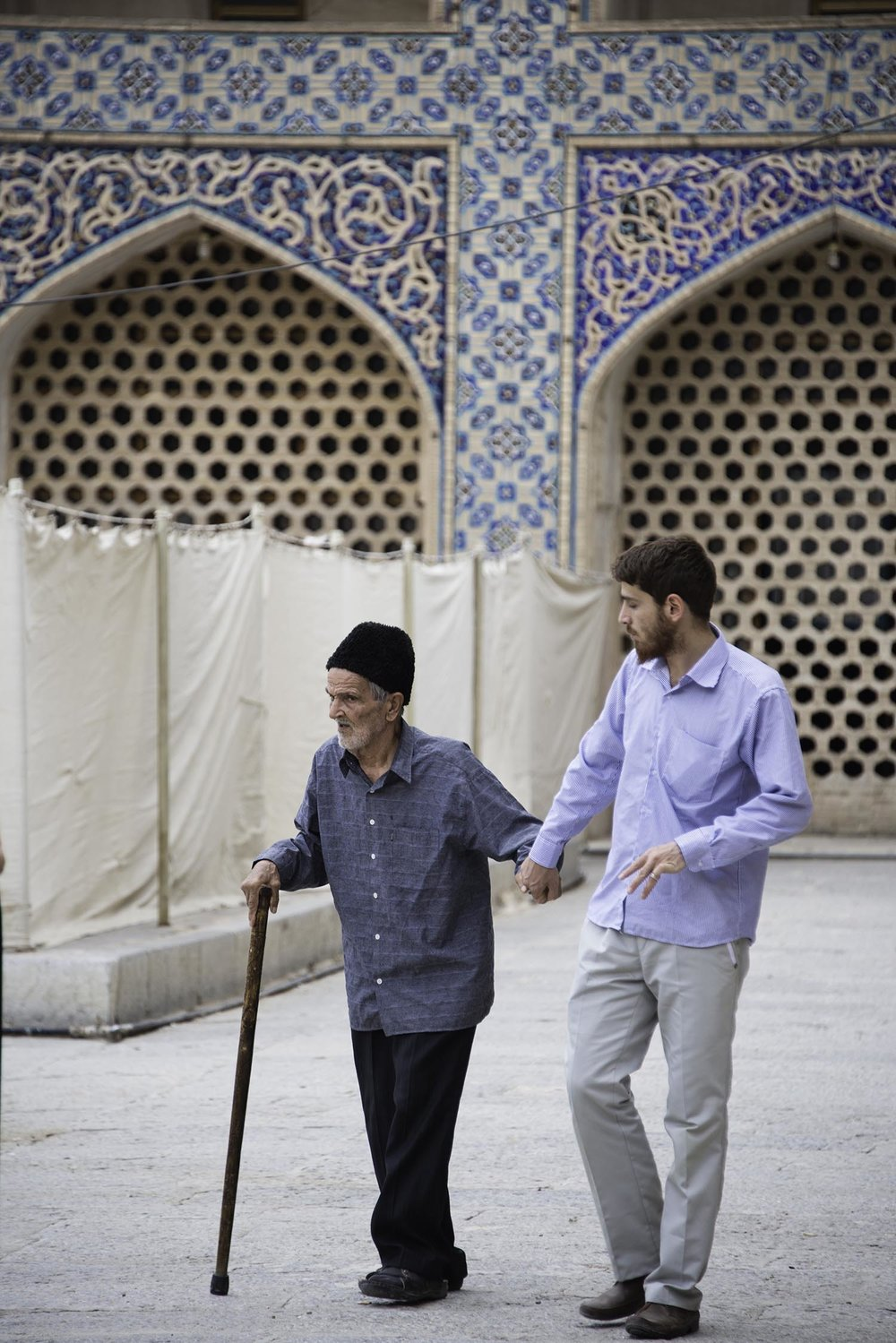 Young Man Walking With Old Man