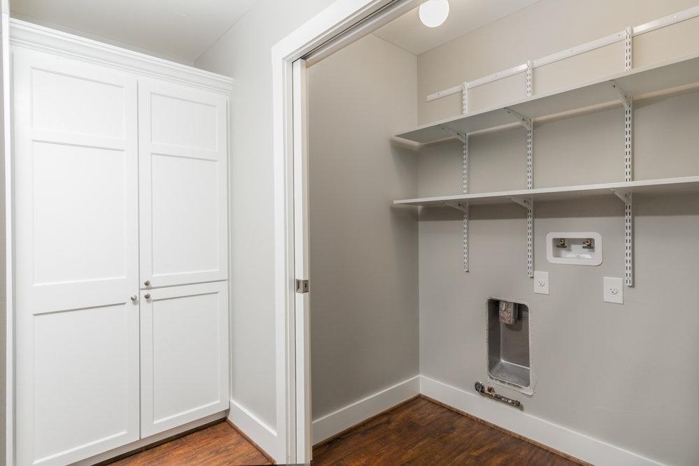 13 laundry area and linen closet.jpg