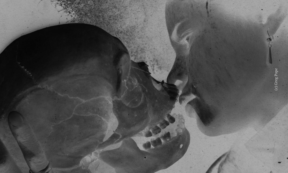 cropped-skull-kiss_credited.jpg