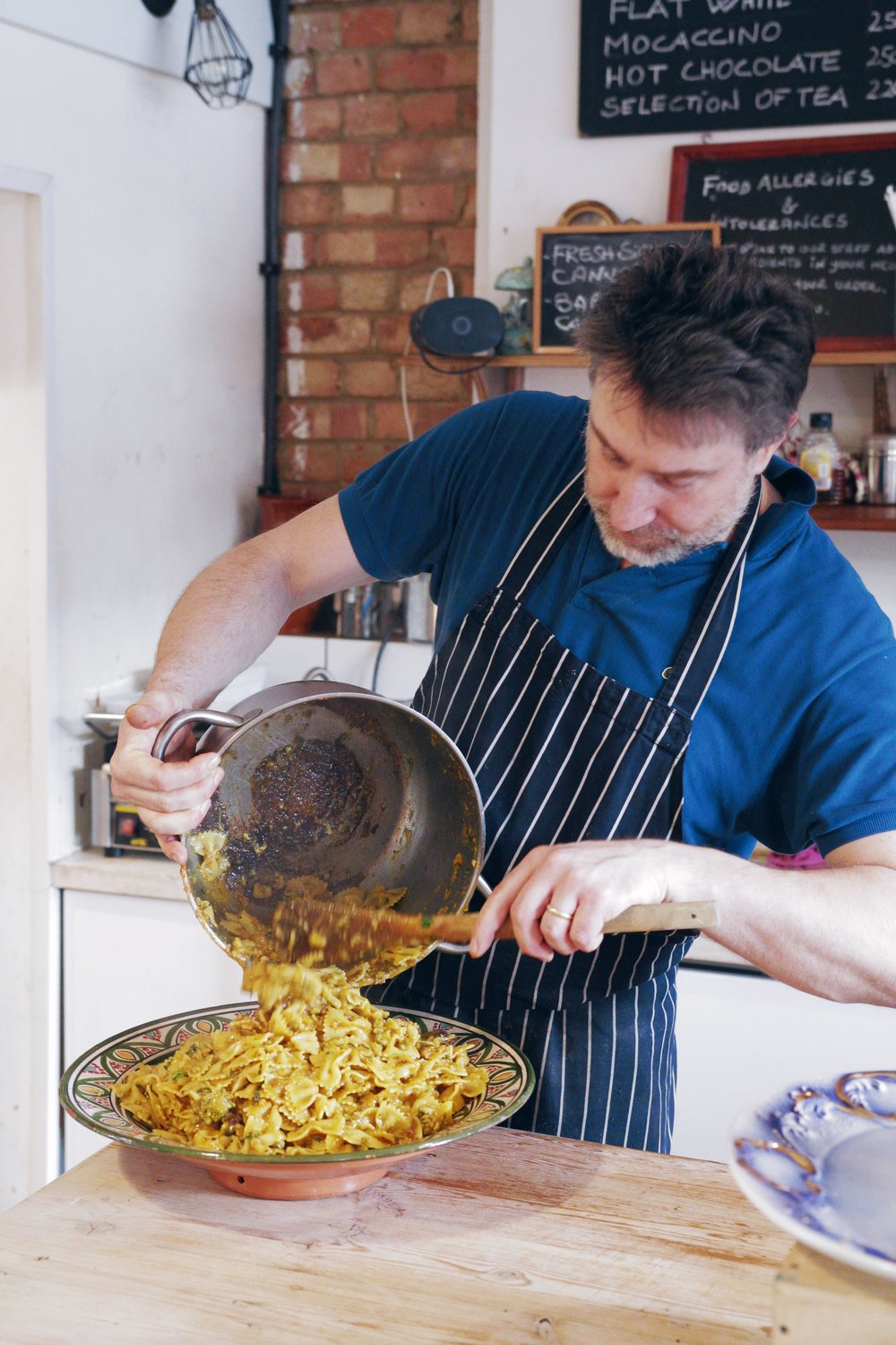 Giuseppe serving up a delicious Sicilian pasta recipe.  Photography by Vlad Muko.