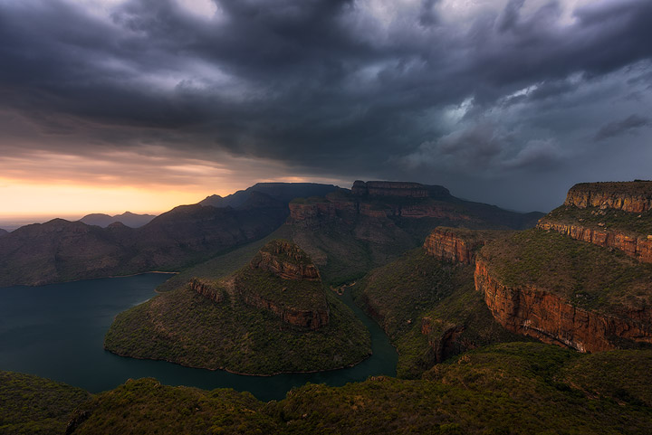 A massive summer thunderstorm whips across the rugged landscape of the Blyde River Canyon, engulfing the scene in rain moments after this image was captured.