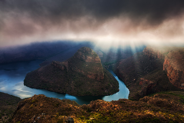 Heavy mist shrouds the Blyde River Canyon, giving way to seconds of peering light, creating an ethereal mood to the incredible landscape. I waited three hours in the same location for this image, hoping for something spectacular to happen, and that patience was rewarded with incredible rays of sunlight illuminating the Canyon walls.