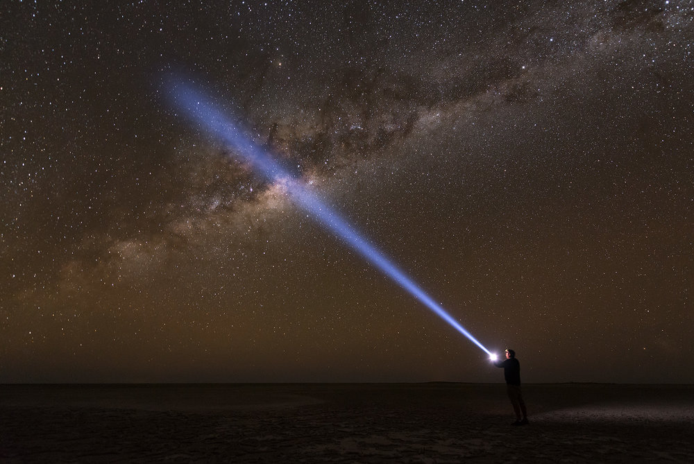 Night sky Milky Way torch person light beam Makgadikgadi Salt Pans Botswana Kubu Island Landscape Nocturnal night photo