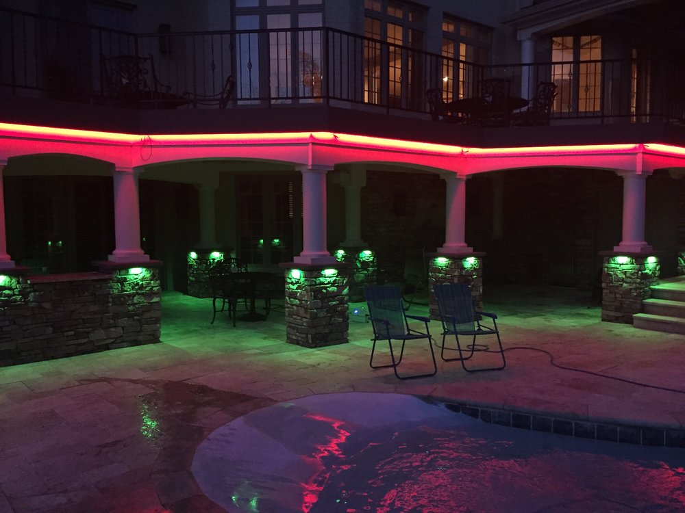 Outdoor patio lights in color and white.
