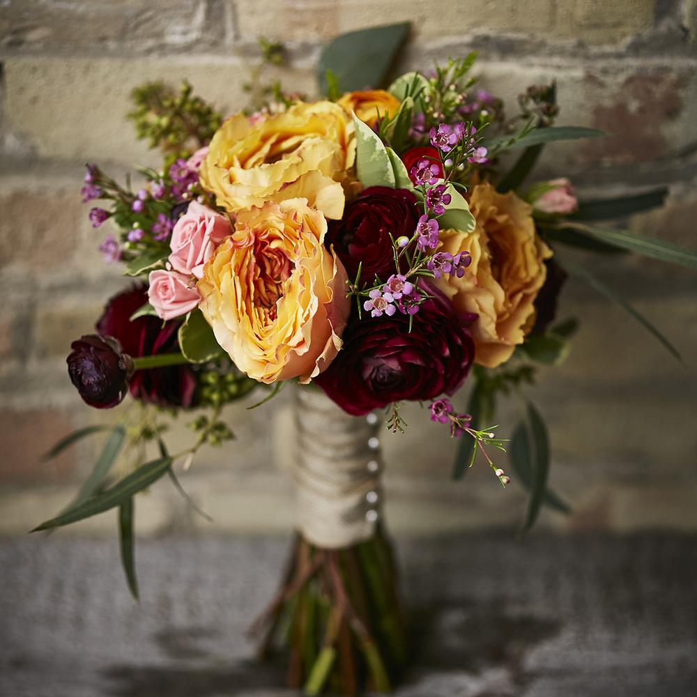 Wine & Apricot   Romantic bouquet featuring garden roses & ranunculus