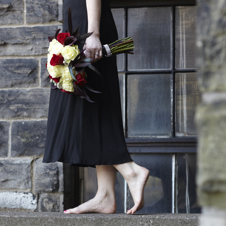 Dramatic Red | Bridal bouquet featuring calla lilies, roses & ostrich feathers