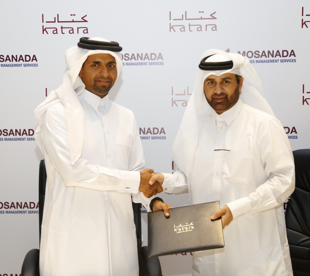 Mosanada Chairman Abdulaziz Al-Mahmoud (left) and Dr. Khalid Bin Ibrahim Al-Sulaiti right celebrate the new partnership between Mosanada FMS and Katara Cultural Village.