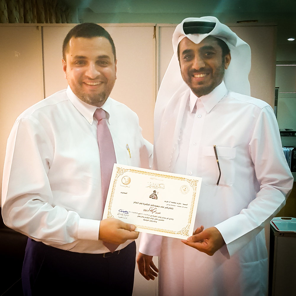 Hazem Khraim (Senior Manager - Operations) receives his certificate from 2nd Lieutenant, Khalid Ali Al-Buainain (Lekhwiya Officer)