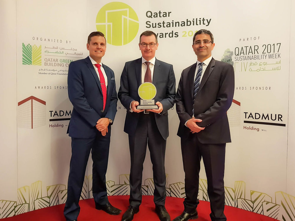 Left to Right: Adam Wood (Deputy Director), Martin Campbell (Director), Mustafa Adra (Project Director) with the award for Facility Management Organisation at the 2017 Qatar Sustainability Awards.
