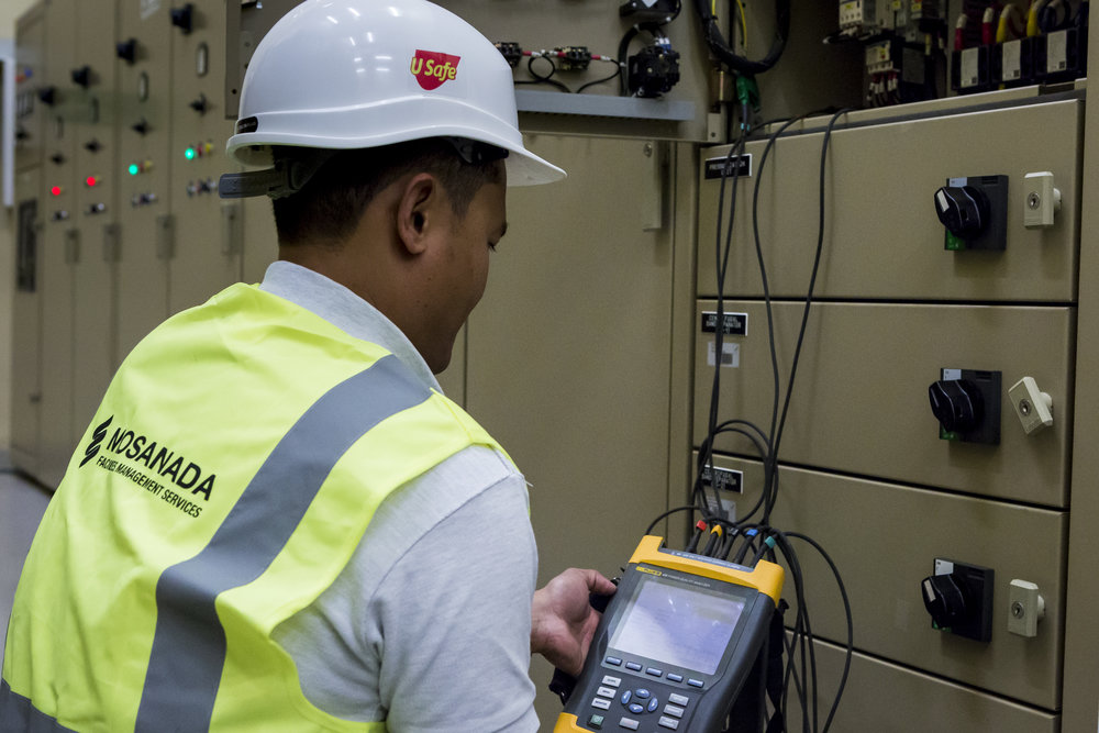 A Mosanada Engineer uses a Power Analyser to collect energy interval data during an Energy Audit.
