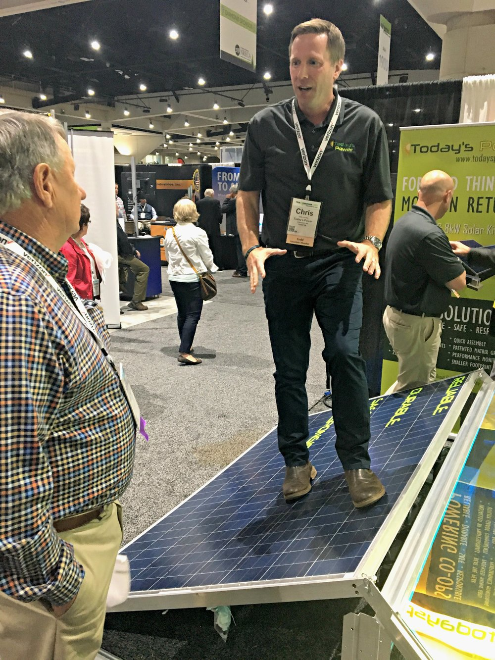 Director of Business Development, Chris Burnley demonstrates module durability to Co-op leaders on the TechAdvantage floor.