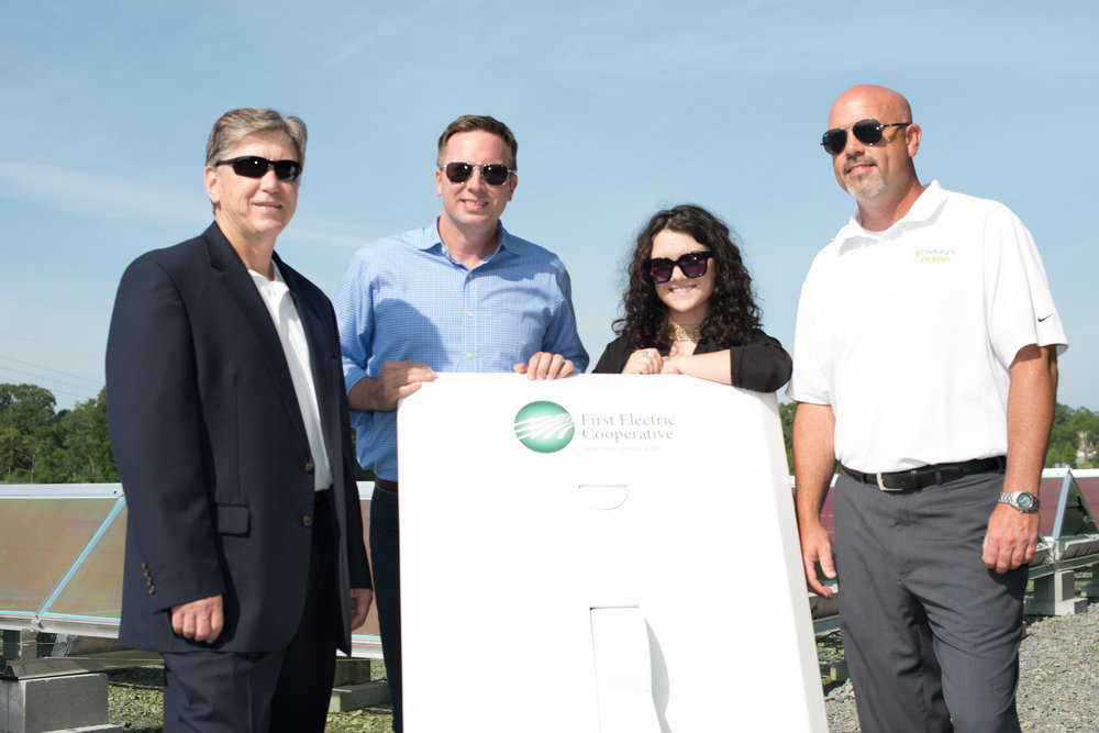 Representatives from the Today's Power team at the dedication for First Electric's 1 MW Solar Field. (Left to Right:  Michael Henderson, Chris Burnley, Jennah Denney and Matt Irving.