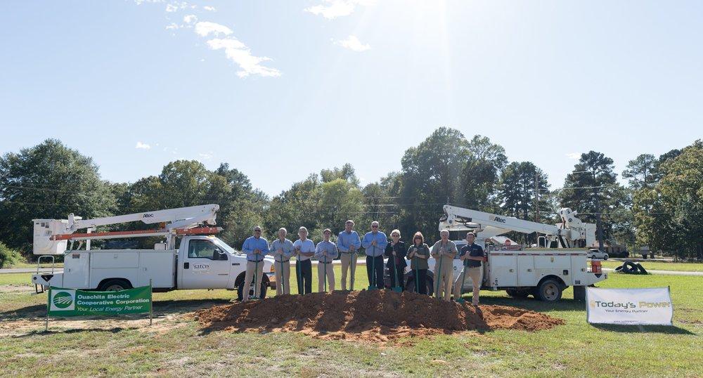 Members of TPI, SATCO, & OECC break ground at future solar site. (From left to right: Matt Irving (TPI), (SATCO), David Wells (SATCO), Lang Wells (SATCO), Mark Lundy (SATCO), Mark Cayce (OECC), Wanda Taylor (OECC), Lisa Hendrix (OECC), Dr. Corbit Lamkin (OECC), Robby Stinnett (OECC).)