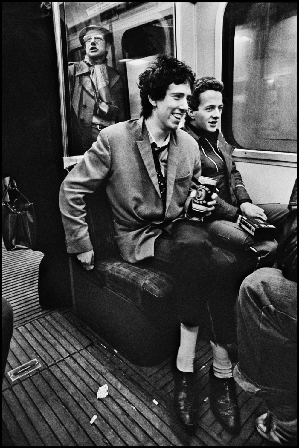 The Clash on the Circle Line 1977 On April 7th 1977 the first Clash LP was released. We put them on the cover of the NME to coincide with this pivotal moment in Rock history. Their manager, Bernie Rhodes, decided that to maintain maximum street credibility the photos and the interview should be done on the Circle Line. Tony Parsons and I were to meet the band at midday on the Baker Street platform. We started the interview but it was incredibly noisy. I took photos but the moving train was not the easiest place to work: the smoking car we were in was filthy and I was also worried about camera shake.  In the end we used a close head shot photo for the cover, and this frame was never used. So for more than 35 years it has remained unseen, but I think it stands the test of time quite well. What comes across to me is just how young we all were back then, in 1977.