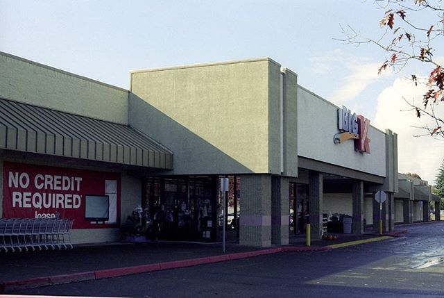 Death of the Department Store Kmart Bend, Oregon October 2018  I haven't done a Death of the Department store in a few months. Sears and by proxy Kmart have been in the news recently in regards to bankruptcy proceedings. In fact the last KMart I tried to visit was closed for good. This one was one of three that remained open in all of Oregon. All of them in blue collar towns.  I've always been oddly fascinated by corporations that have a heavy presence in blue collar America. Even more so ones that are past their prime and never saw it coming. Companies that failed to pivot or remain relevant.  It surreal to take these photos sometimes.  As someone who works in film, you want your work to be relevant. With this it's the long game. In this case I think it's important to look 30 or 40 years ahead. Maybe even after you die someone will find your photos and be able to see what shopping was like before everything was delivered right to your door. ⠀⠀⠀⠀⠀⠀⠀⠀⠀ ⠀⠀⠀⠀⠀⠀⠀⠀⠀ #kodak #5219 #filmisnotdead #lekkerzine #lensculture #moodygrams #dreamermagazine #myfeatureshot #somewheremagazine #visualsoflife #subjectivelyobjective #filmphotographic #noicemag #dazedandexposed #minimalzine #35mm #lighting #ig_onstandby #cineminer #deathoftgedepartmentstore #nowherediary #oftheafternoon #cinematography #thinkverylittle #broadmag #ourmomentum #25bluehours #imaginarymagnitude #ifyouleave #goldmoony