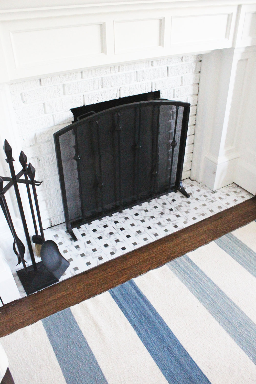 Updated fireplace! Fresh whites and faux-marbles, yummy!