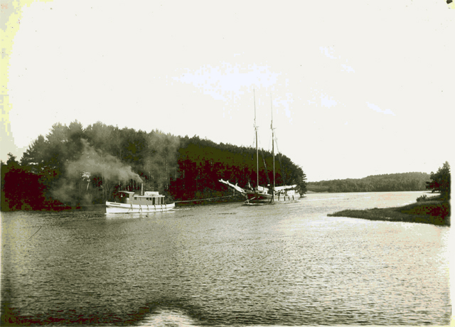 The tug Iva towing the two-masted schooner Ada J. Campbell from Great Bay to Exeter, circa 1900. Courtesy of the Exeter Historical Society.