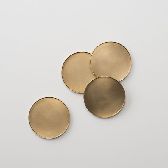 Brass coasters via schoolhouseelectric.com