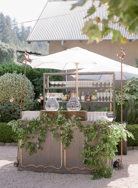 Modern Organic Wine Country Wedding Bar with teardrop water canisters and wild greens by Scarlett and Grace, cake by Cake Bloom, planning by Napa Valley Celebrations | Meg Smith Photography