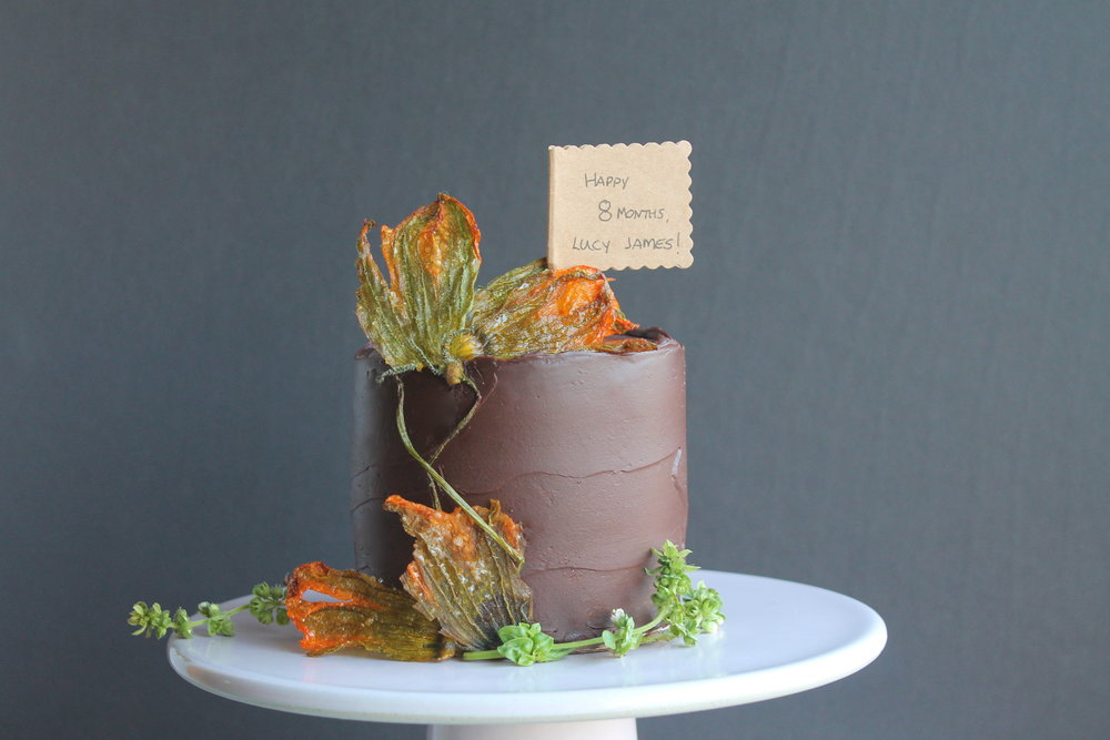 Chocolate Zucchini Baby Cake with Candied Squash Blossoms and Chocolate Basil Ganache