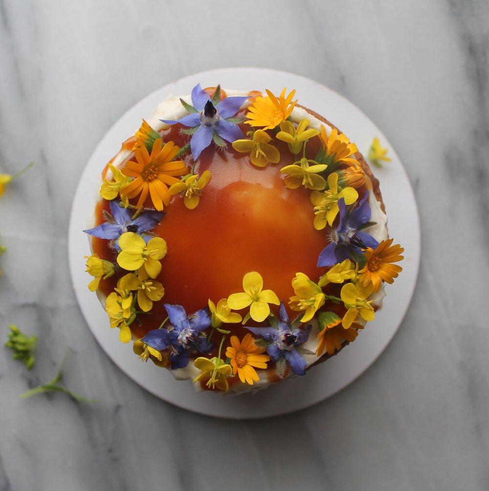 Edible flower cake with calendula, mustard, borage by Cake Bloom