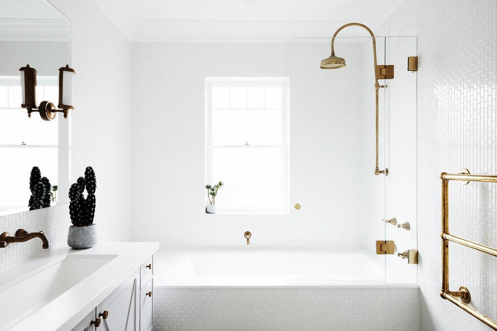 White Bathroom with Chrome Highlights