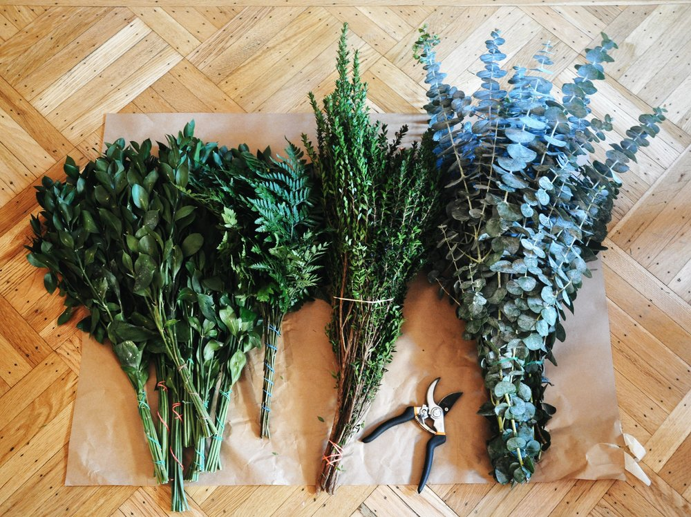 Ruscus, Cleopatra Fern, Myrtle, and   Eucalyptus (in order)