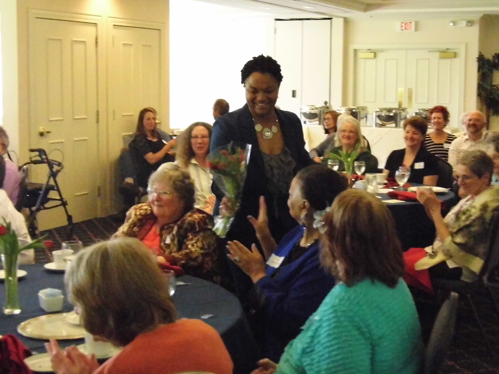 At a recent keynote at a Country Club, Michelle hands her mother flowers.
