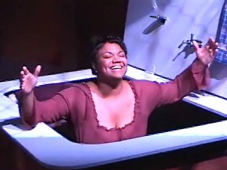 "Michelle in her solo play, ""Labor,"" in a scene detailing her birth story. Written by Michelle Courtney Berry and directed by Robert Anthony Hubbell. World premiere - Kitchen Theatre."