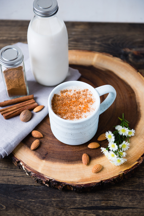 SPICED ALMOND MILK.   While cleansing, we encourage our cleansers to  drink this each evening  during the 21-day whole food program. The combination of spices and nutty-sweetness is a perfect way to end the day, and it's  so easy to make at home  which means you're saving tons of hard-earned cash.