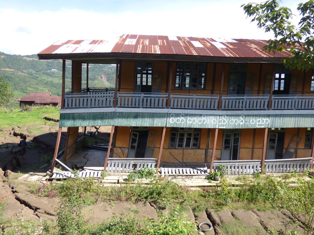 "An abandoned school in the ""red zone"" area of the landslide, which is now not permitted to be settled"