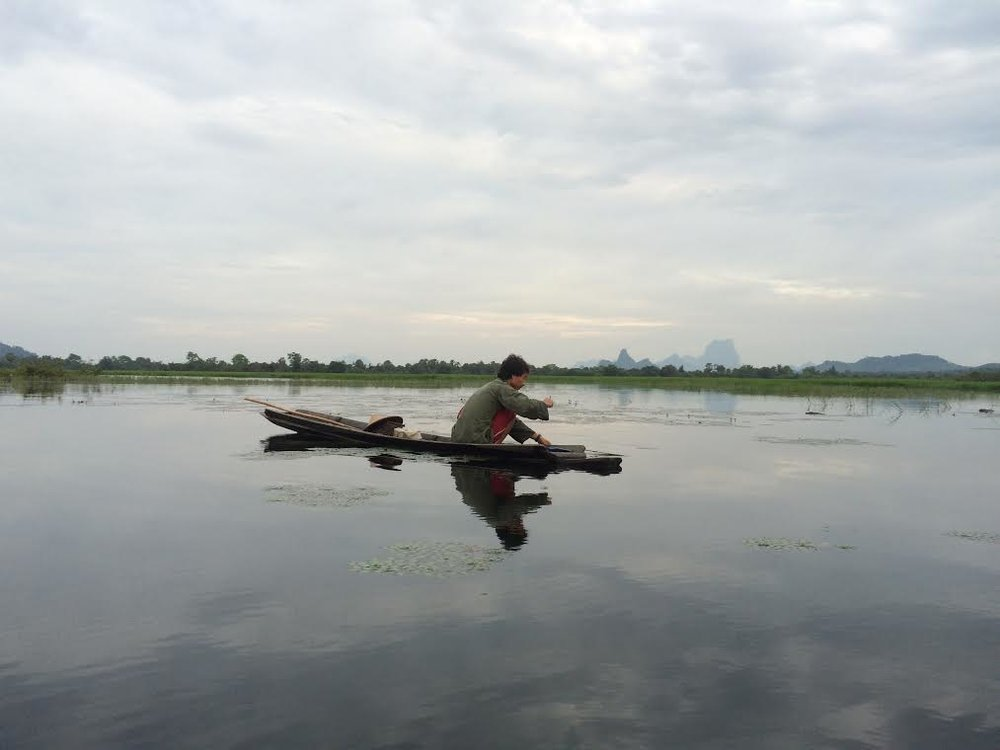 Villager fishing in Dawla Lake near Mikayin Village in Hpa-an, Karen state, Myanmar (Saw John Bright, 2017)