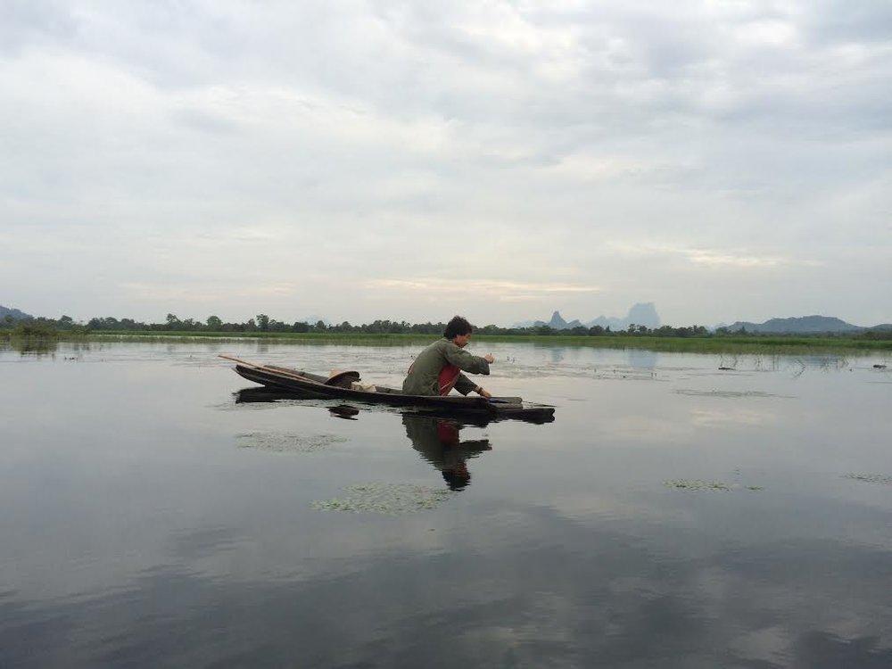 Villager fishing in Dawla Lake near Mikayin Village in Hpa-an, Karen state, Myanmar (Saw John Bright, 2017)