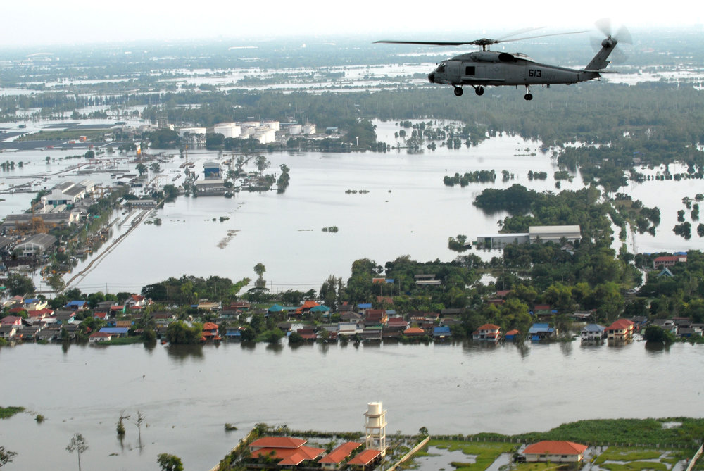 An SH-60F Sea Hawk helicopter assigned to Helicopter Anti-Submarine Squadron (HS) 14, flies around the Bangkok area with members of the humanitarian assessment survey team and the Royal Thai Armed Forces to assess the damage caused by flooding (Source: Jennifer Villalovos, WikiCommons)