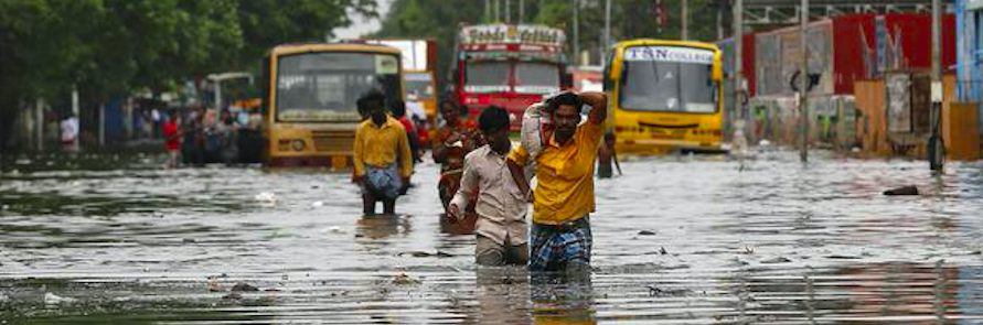 People wade through a flooded road in Chennai, India, December 5, 2015 (Source: REUTERS)