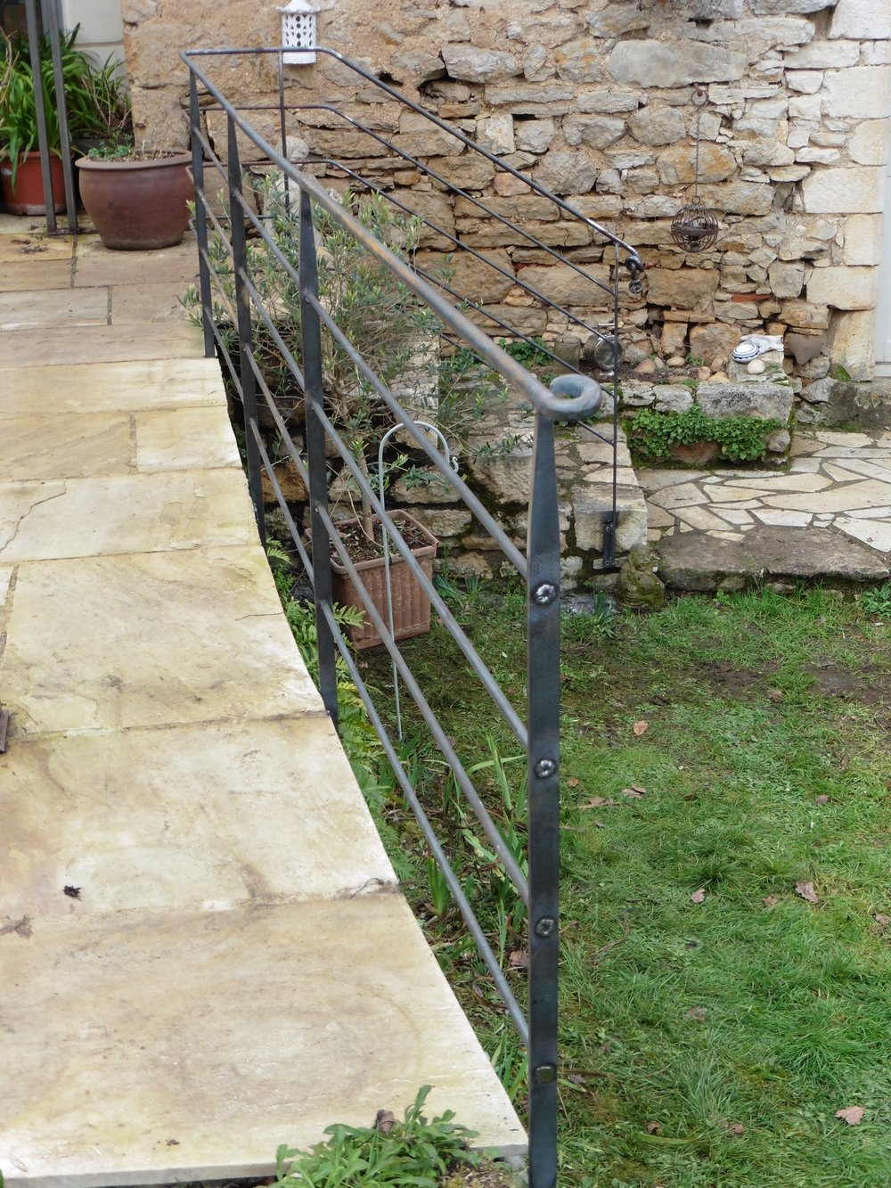 Simple but stylish railings at a lovely old water mill.
