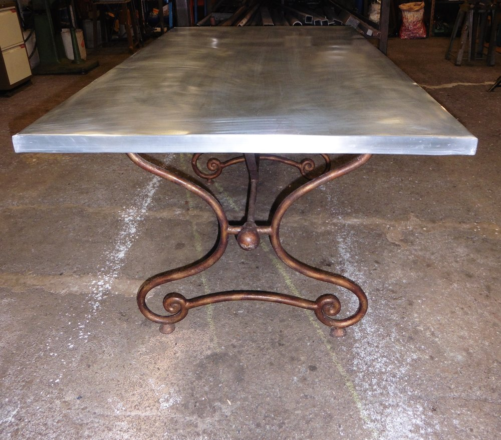 Table which we topped with zinc for outdoor use.