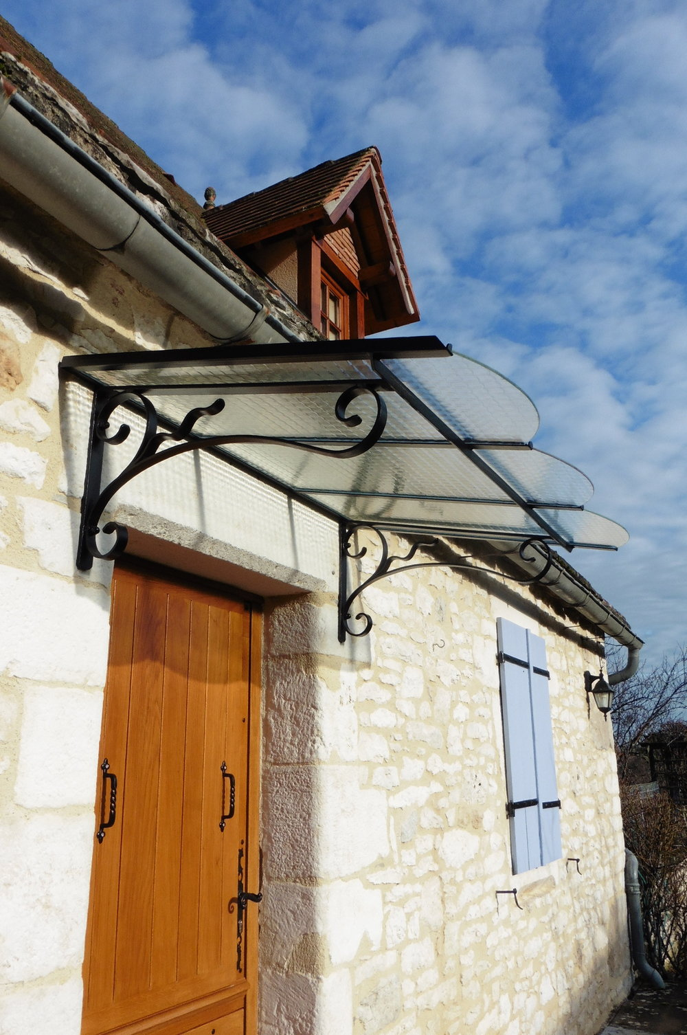 A contemporary twist to this overhead porch at a very pretty, stone house.