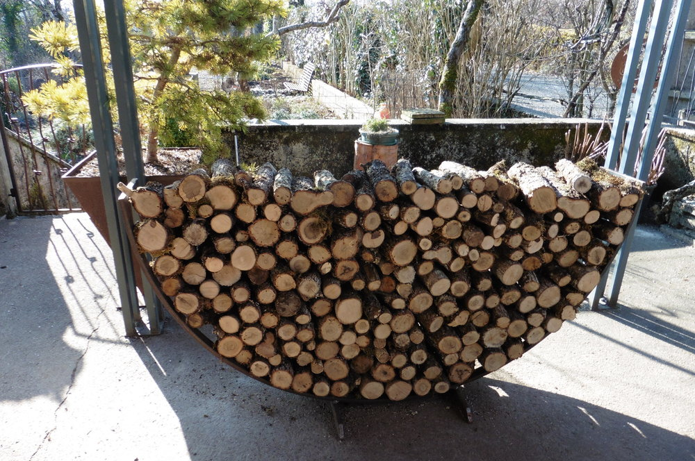 ...or outside, it can do its job of holding a mighty stack of logs!