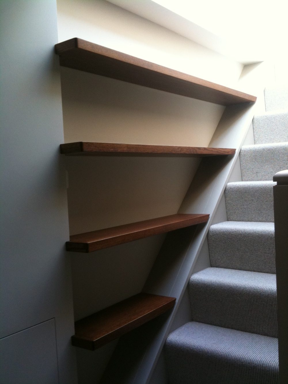 Stained Oak floating shelves.