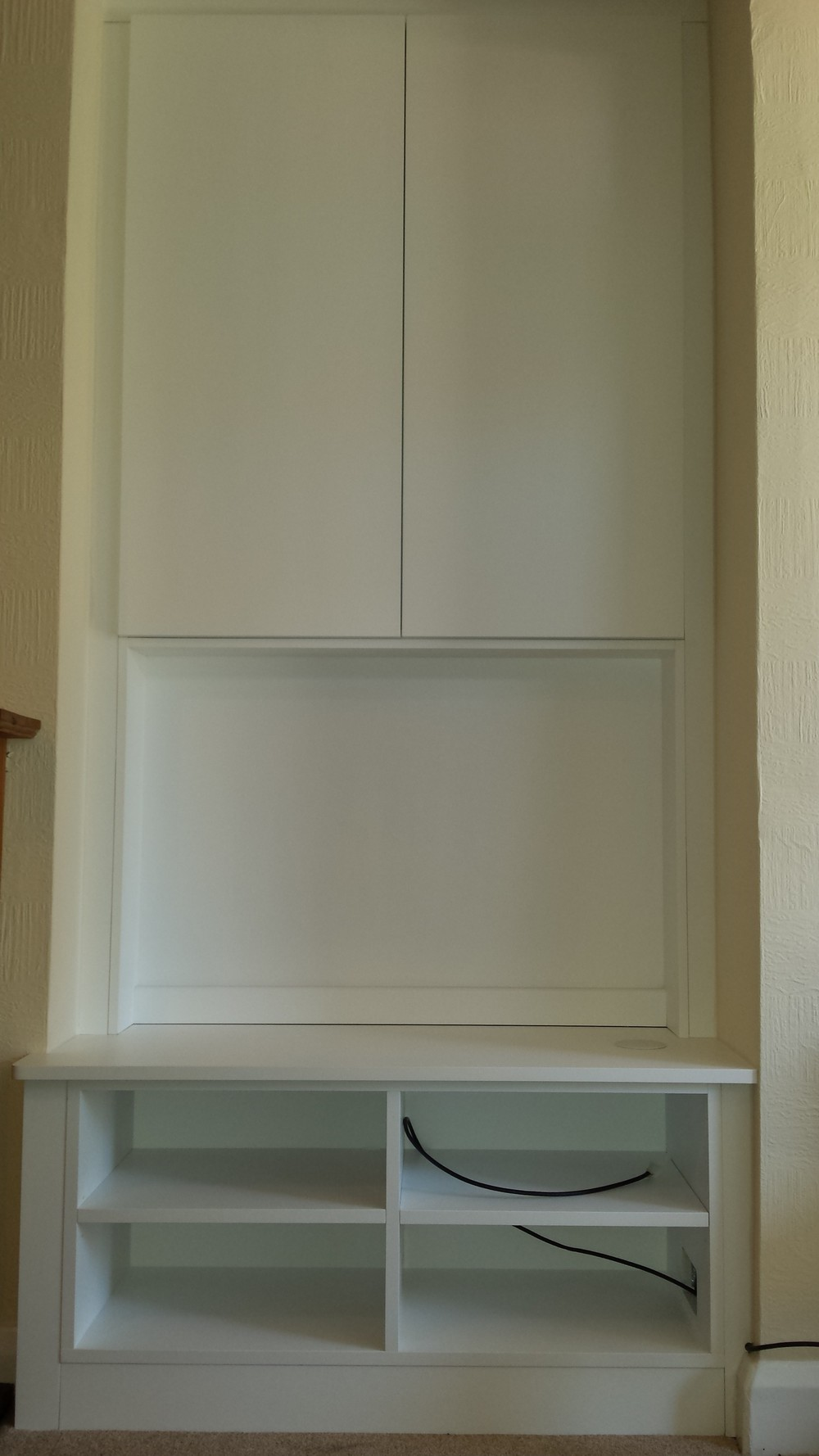 TV enclosure with cupboards above