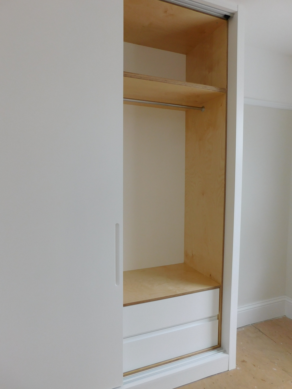 Drawer set behind sliding doors