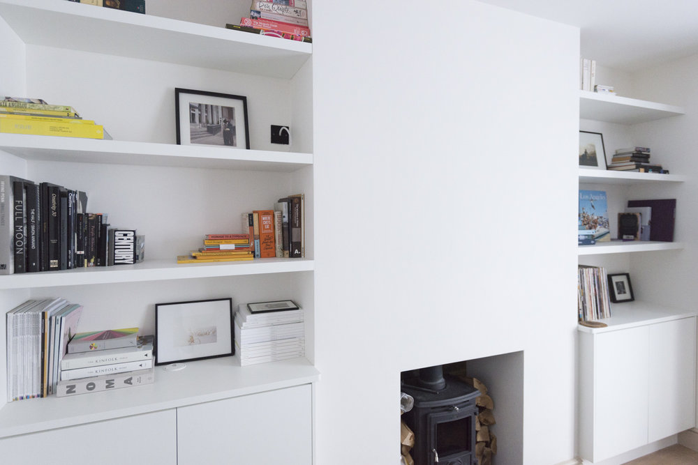 Contemporary alcove cabinets with floating shelves