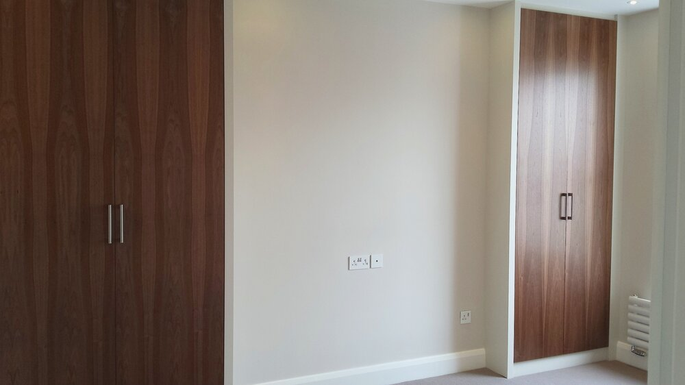 Wardrobes with Walnut wood doors.