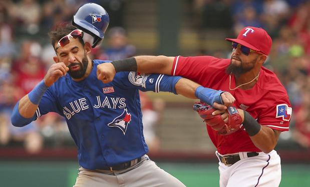 Rangers second baseman Rougned Odor takes a swing at Blue Jays slugger Jose Bautista. Image:Richard W. Rodriguez