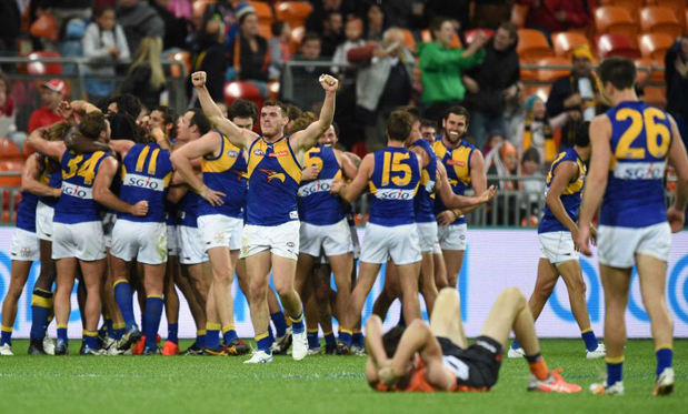The Eagles celebrate their last-gasp Round 21 win over the Giants. Image: AAP/Dan Himbrechts
